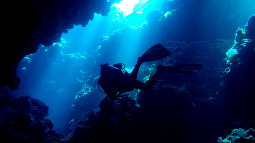 Diving through a cave in Fiji
